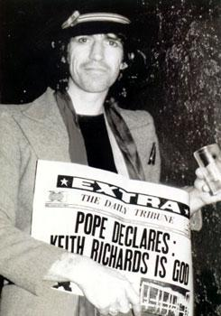 Keith Richards poses with newspaer with headline, Pope Declares Keith Richards is God